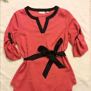 Bright pink/red tunic